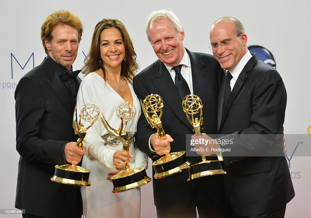 Producers Jerry Bruckheimer, Elise Doganieri, Bertram van Munster and Jonathan Littman poses in the 64th Annual Emmy Awards press room at Nokia Theatre L.A. Live on September 23, 2012 in Los Angeles, California.