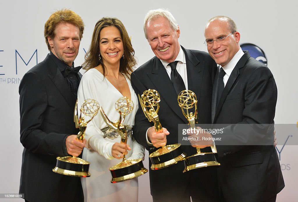 Producers <a gi-track='captionPersonalityLinkClicked' href=/galleries/search?phrase=Jerry+Bruckheimer&family=editorial&specificpeople=203316 ng-click='$event.stopPropagation()'>Jerry Bruckheimer</a>, <a gi-track='captionPersonalityLinkClicked' href=/galleries/search?phrase=Elise+Doganieri&family=editorial&specificpeople=2082543 ng-click='$event.stopPropagation()'>Elise Doganieri</a>, Bertram van Munster and <a gi-track='captionPersonalityLinkClicked' href=/galleries/search?phrase=Jonathan+Littman&family=editorial&specificpeople=740002 ng-click='$event.stopPropagation()'>Jonathan Littman</a> poses in the 64th Annual Emmy Awards press room at Nokia Theatre L.A. Live on September 23, 2012 in Los Angeles, California.