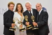 Producers Jerry Bruckheimer Elise Doganieri Bertram van Munster and Jonathan Littman poses in the 64th Annual Emmy Awards press room at Nokia Theatre...