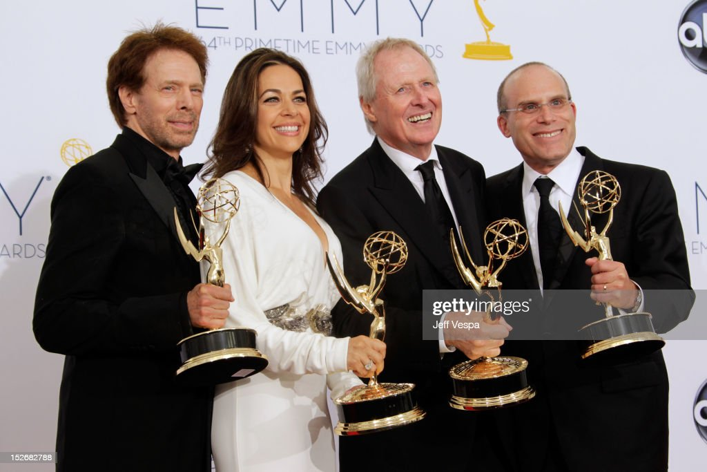 Producers Jerry Bruckheimer, Elise Doganieri, Bertram van Munster and Jonathan Littman pose in the press room during the 64th Primetime Emmy Awards at Nokia Theatre L.A. Live on September 23, 2012 in Los Angeles, California.