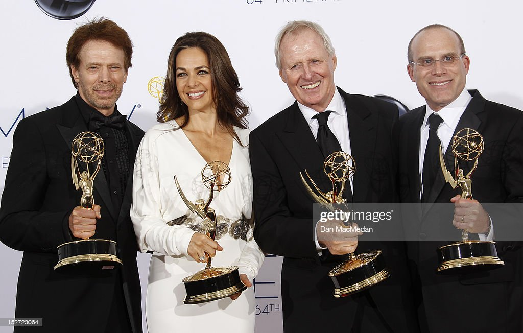 Producers Jerry Bruckheimer, Elise Doganieri, Bertram van Munster and Jonathan Littman pose in the press room at the 64th Primetime Emmy Awards held at Nokia Theatre L.A. Live on September 23, 2012 in Los Angeles, California.