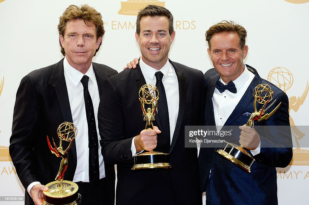 Producers John de Mol, <a gi-track='captionPersonalityLinkClicked' href=/galleries/search?phrase=Carson+Daly&family=editorial&specificpeople=202941 ng-click='$event.stopPropagation()'>Carson Daly</a> and Executive Producer <a gi-track='captionPersonalityLinkClicked' href=/galleries/search?phrase=Mark+Burnett&family=editorial&specificpeople=204697 ng-click='$event.stopPropagation()'>Mark Burnett</a>, winners of the Outstanding Reality - Competition Program Award for 'The Voice' pose in the press room during the 65th Annual Primetime Emmy Awards held at Nokia Theatre L.A. Live on September 22, 2013 in Los Angeles, California.