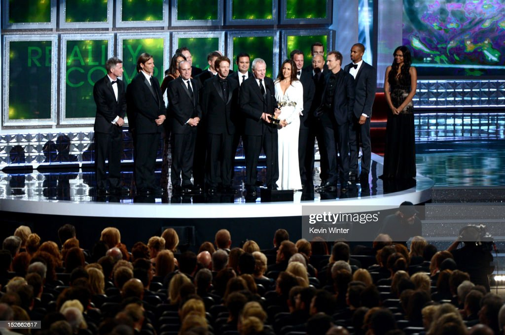 Producers Jonathan Littman, Jerry Bruckheimer, Bertram van Munster, Elise Doganieri and other producer accept Outstanding Reality-Competition Program for 'The Amazing Race' onstage during the 64th Annual Primetime Emmy Awards at Nokia Theatre L.A. Live on September 23, 2012 in Los Angeles, California.