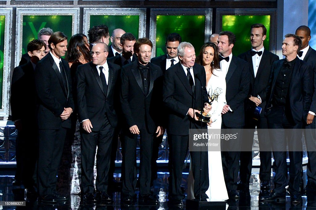 Producers Jonathan Littman, Jerry Bruckheimer, Bertram van Munster, Elise Doganieri and other producers accept Outstanding Reality-Competition Program for 'The Amazing Race' onstage during the 64th Annual Primetime Emmy Awards at Nokia Theatre L.A. Live on September 23, 2012 in Los Angeles, California.