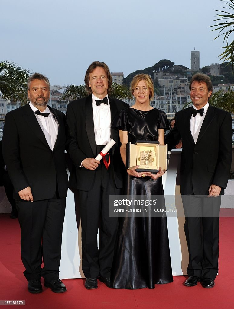 Producers (From L) Luc Besson, Bill Pohlad, Dede Gardner and Grant Hill pose during a photocall after receiving on behalf of US director Terrence Malick the Palme D'Or for the movie 'The Tree of Life' at the 64th Cannes Film Festival on May 22, 2011 in Cannes. AFP PHOTO / ANNE-CHRISTINE POUJOULAT