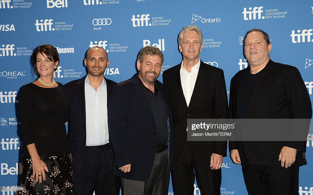 Producers Meghan O'Hara Amir BarLev James Dolan John Sykes and Harvey Weinstein of '121212' pose at the Guess Portrait Studio during 2013 Toronto...
