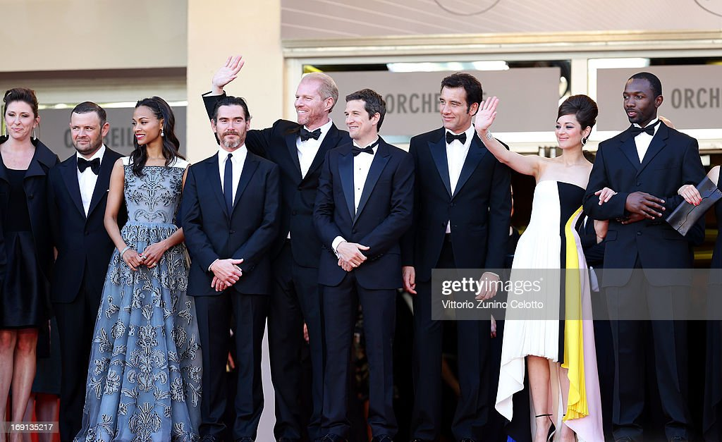 Producers Molly Conners and Christopher Woodrow, actors Zoe Saldana, Billy Crudup and Noah Emmerich, director Guillaume Canet and actors Clive Owen, Marion Cotillard and Jamie Hector attend the 'Blood Ties' Premiere during the 66th Annual Cannes Film Festival at the Palais des Festivals on May 20, 2013 in Cannes, France.