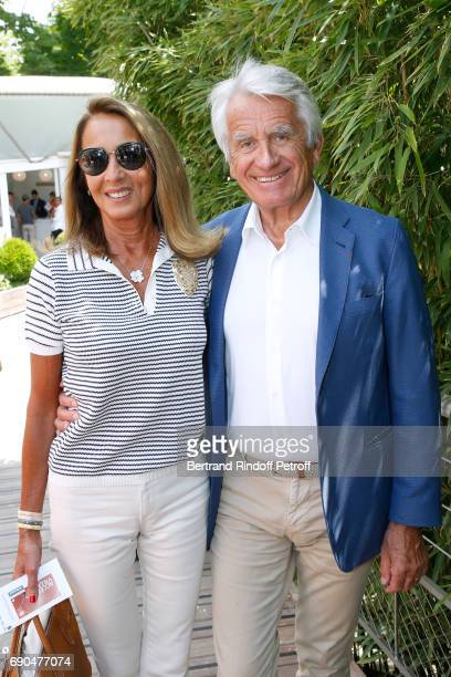 Producers Nicole Coullier and her husband Gilbert Coullier attend the 2017 French Tennis Open Day Four at Roland Garros on May 31 2017 in Paris France