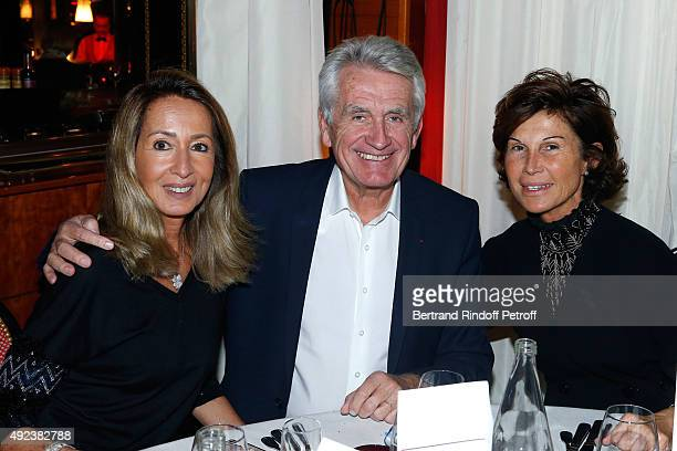 Producers Nicole Coullier her husband Gilbert Coullier and Sylvie Rousseau attend the Fouquet's Paris Restaurant presents its Menu 'Twisted' by the...