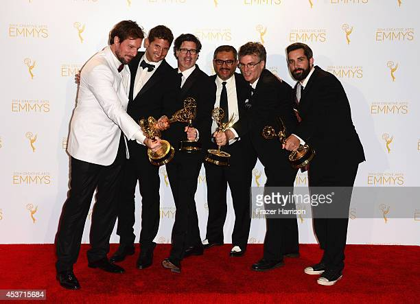 Producers of Discovery Channel's Deadliest Catch pose in the press room during the 2014 Creative Arts Emmy Awards at Nokia Theatre LA Live on August...