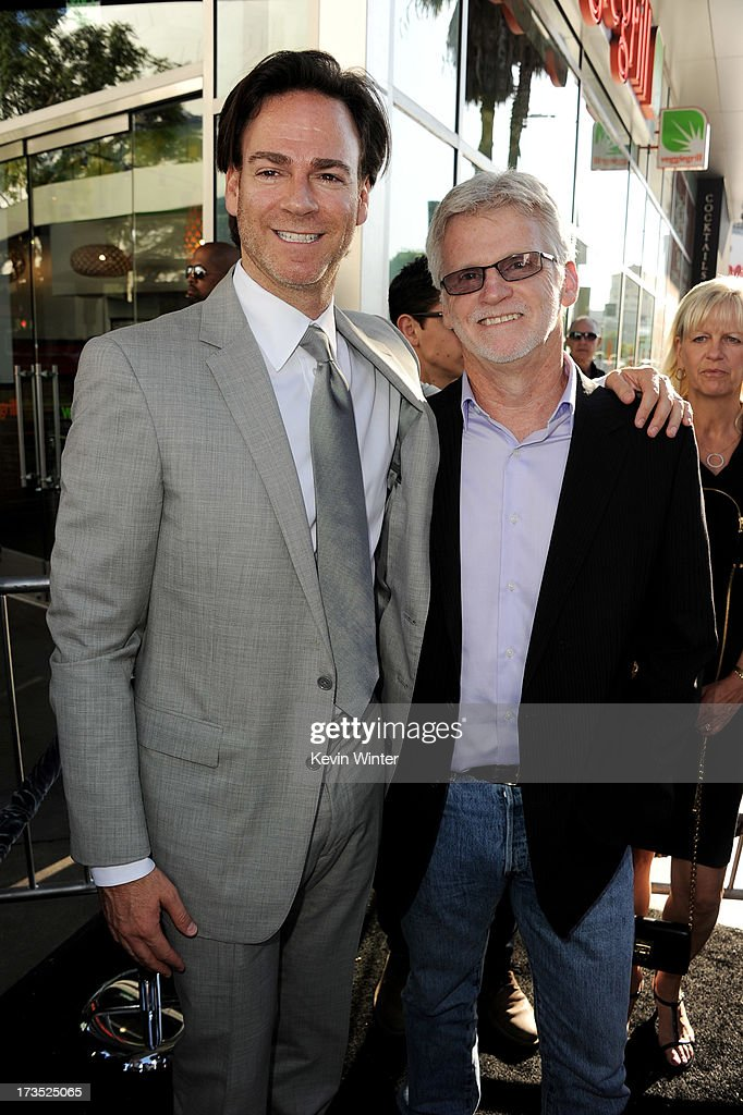 Producers Peter Safran (L) and Rob Cowan arrive at the premiere of Warner Bros. 'The Conjuring' at the Cinerama Dome on July 15, 2013 in Los Angeles, California.