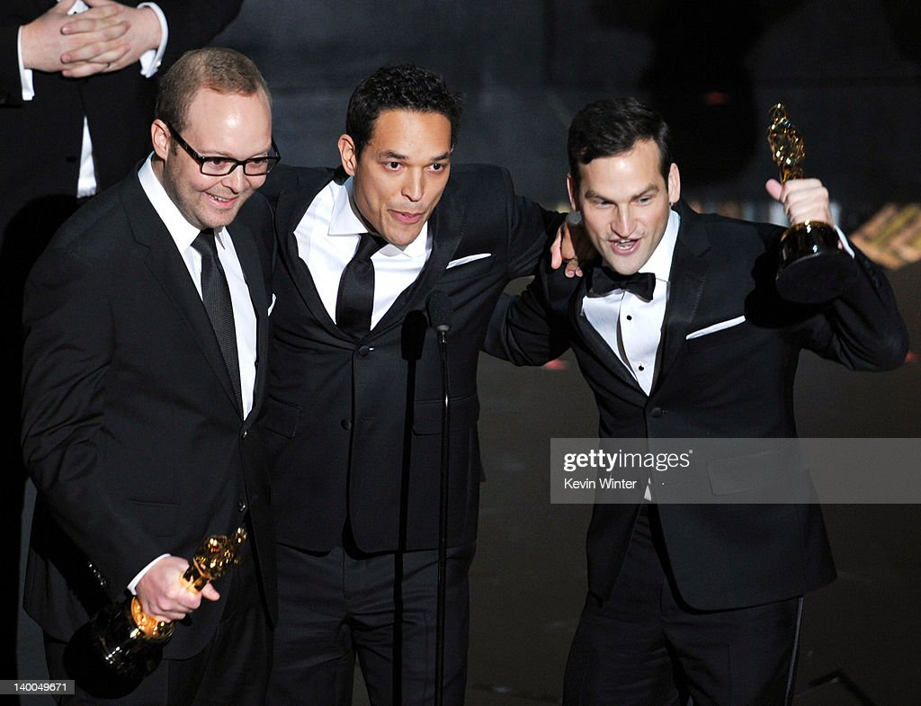 Producers Rich Middlemas, TJ Martin and Dan Lindsay, accept the Best Documentary Feature Award for 'Undefeated,' onstage during the 84th Annual Academy Awards held at the Hollywood & Highland Center on February 26, 2012 in Hollywood, California.