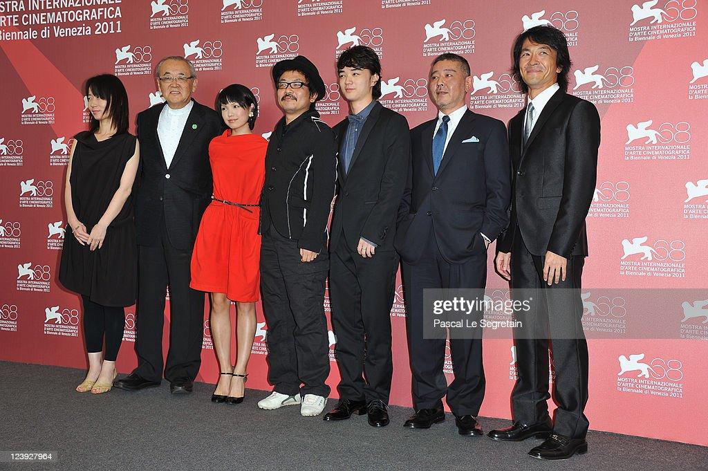 Producers Satomi Odake Tom Yoda actress Fumi Nikaido director Sion Sono actor Shota Sometani producers Haruo Umekawa and Masashi Yamazaki pose at the...