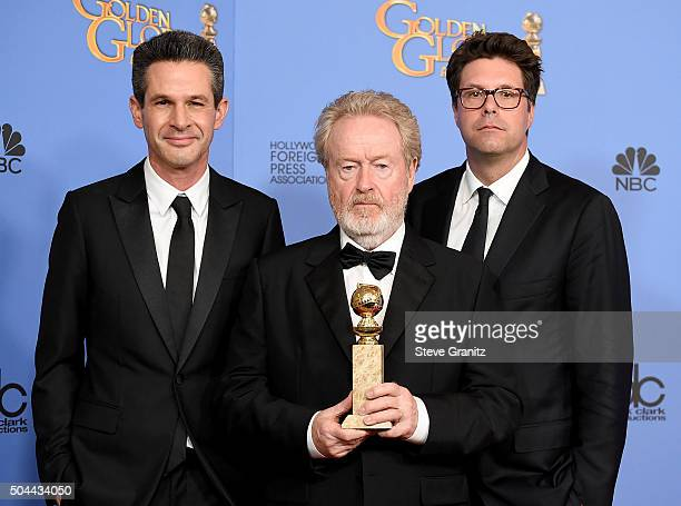 Producers Simon Kinberg Ridley Scott and Michael Schaefer winners of the award for Best Motion Picture Musical or Comedy for 'The Martian' pose in...