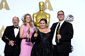 Producers Steve Golin Blye Pagon Faust Nicole Rocklin and Michael Sugar winners of the Best Picture award for 'Spotlight' pose in the press room...