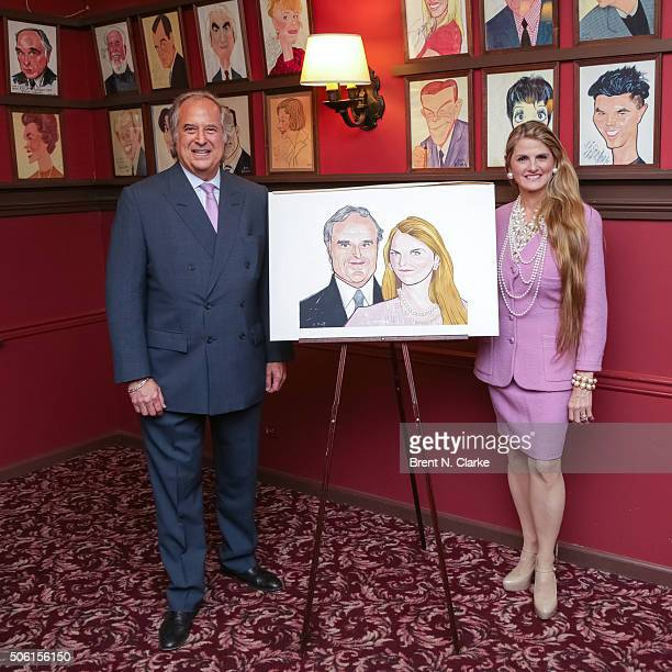 Producers Stewart F Lane and Bonnie Comley pose with their Sardi's portrait during the unveiling ceremony held at Sardi's on January 21 2016 in New...