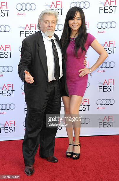 Producers TJ Mancini and Yi Tian attend the screening of 'The Last Emperor' 3D during AFI FEST 2013 Presented By Audi at TCL Chinese Theatre on...