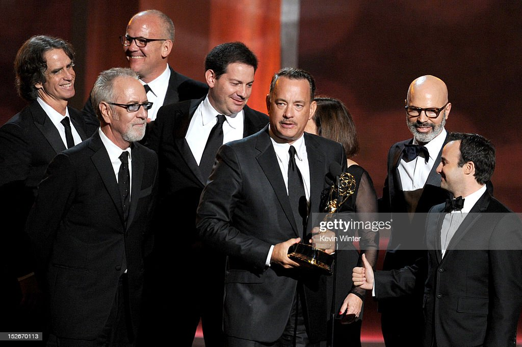 Producers Tom Hanks (C), Jay Roach (far L), Gary Goetzman (2nd L) accept Outstanding Miniseries or TV Movie award for 'Game Change' onstage during the 64th Annual Primetime Emmy Awards at Nokia Theatre L.A. Live on September 23, 2012 in Los Angeles, California.