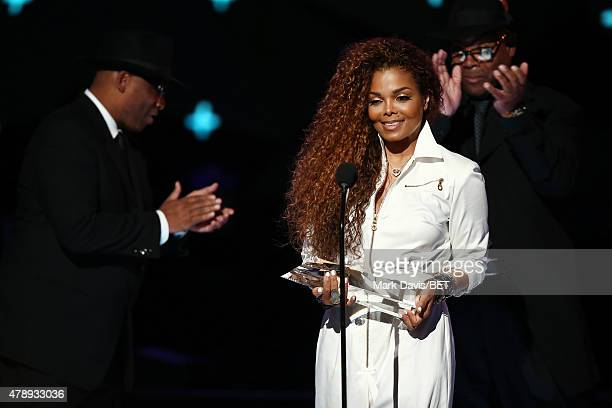 Producer/songwriters Terry Lewis and Jimmy Jam present honoree Janet Jackson with the Ultimate Icon Award onstage during the 2015 BET Awards at the...