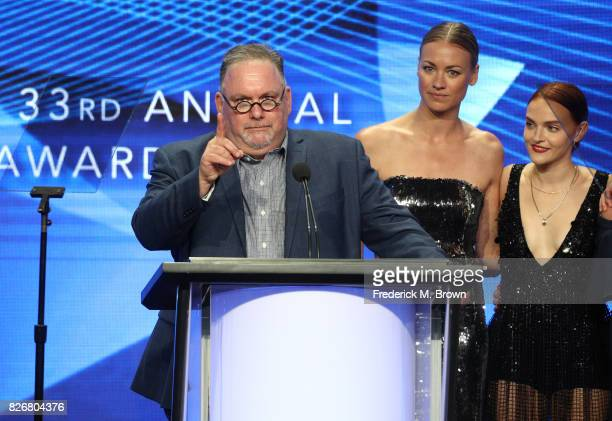 Producer/writer Bruce Miller and actors Yvonne Strahovski and Madeline Brewer accept the award for 'Outstanding Achievement in Drama' for 'The...