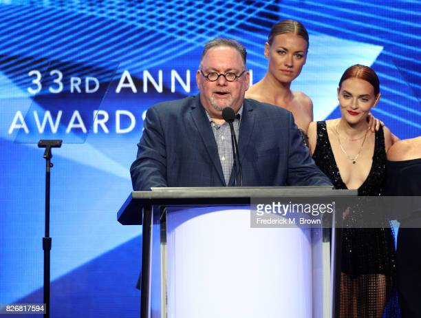 Producer/writer Bruce Miller and actors Yvonne Strahovski and Madeline Brewer accept the award for 'Program of the Year' for 'The Handmaid's Tale'...