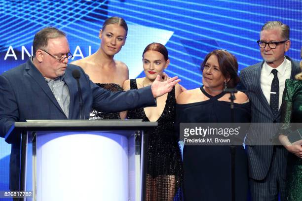 Producer/writer Bruce Miller and actors Yvonne Strahovski Madeline Brewer Ann Dowd and Executive Producer Warren Littlefield accept the award for...
