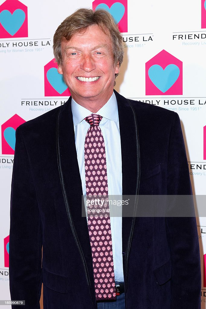 Producr <a gi-track='captionPersonalityLinkClicked' href=/galleries/search?phrase=Nigel+Lythgoe&family=editorial&specificpeople=736462 ng-click='$event.stopPropagation()'>Nigel Lythgoe</a> arrives at the Friendly House Los Angeles Annual Awards Luncheon at The Beverly Hilton Hotel on October 26, 2013 in Beverly Hills, California.