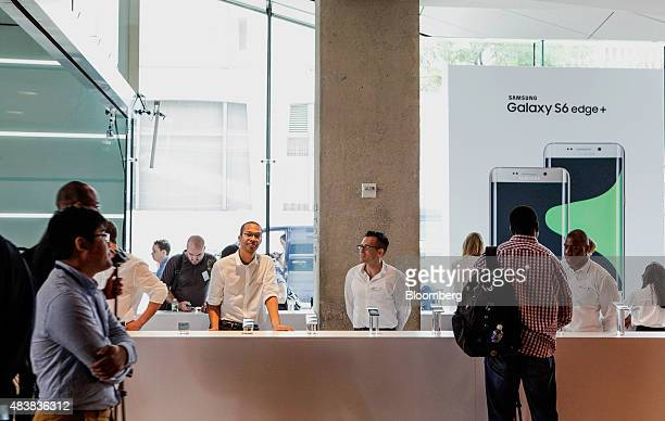 Product experts wait to assist attendees during the Samsung Electronics Co Unpacked 2015 event in New York US on Thursday Aug 13 2015 Samsung will...