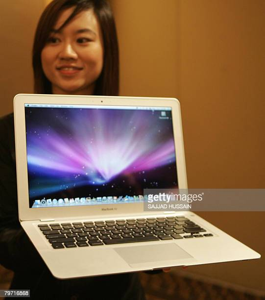 Product marketing manager of Apple Computer Angeline Tan displays the world's thinnest notebook 'MacBook Air' in Mumbai on Feburary 12 2008 The...