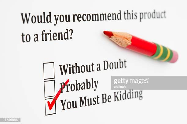 Product satisfaction survey with checkboxes and red pencil