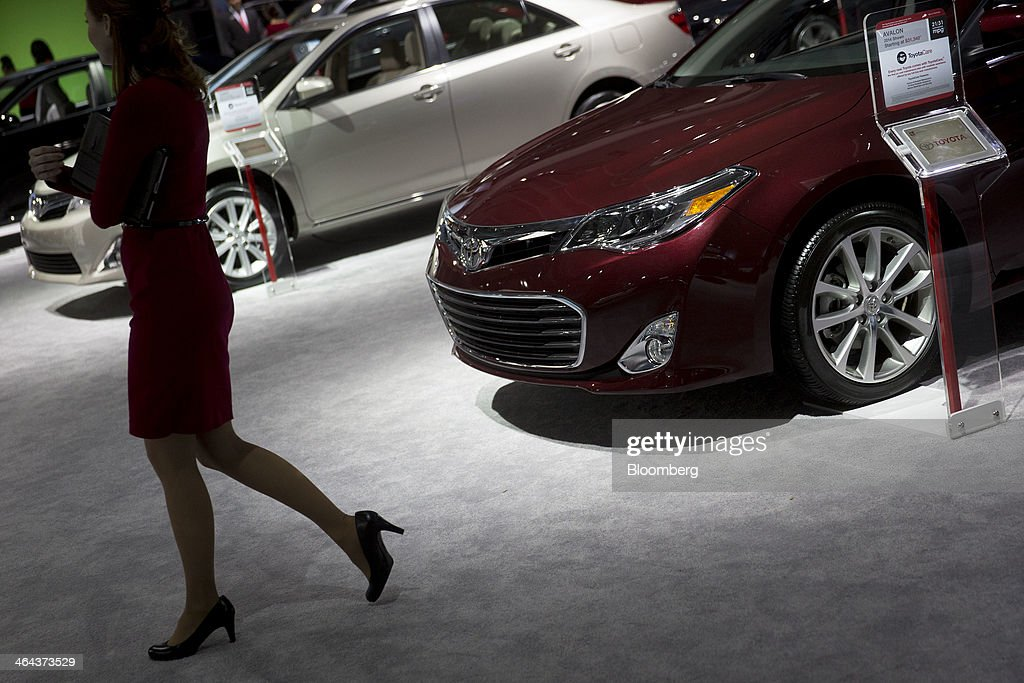 A product specialist walks past a Toyota Motor Corp. Avalon vehicle on display at the Washington Auto Show in Washington, D.C., U.S., on Wednesday, Jan. 22, 2014. Toyota Motor Corp. and Honda Motor Co. set production records at their North American auto-assembly plants last year even as the yen weakened against the dollar for a second consecutive year. Photographer: Andrew Harrer/Bloomberg via Getty Images