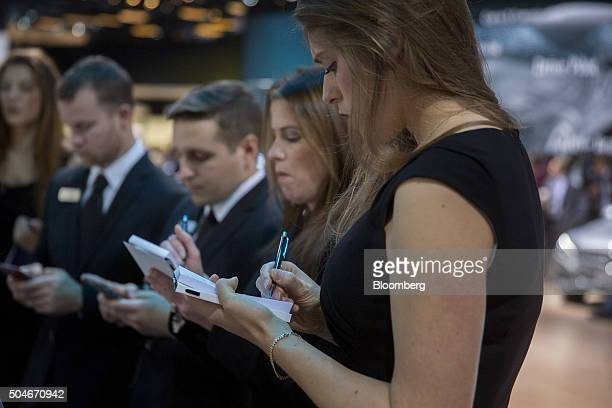 Product specialists take notes while training in the Daimler AG Mercedes Benz booth during the 2016 North American International Auto Show in Detroit...