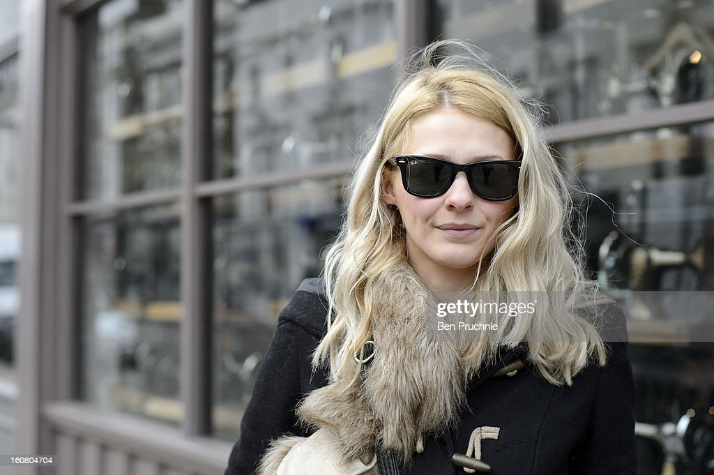 TV production assistant Natalie (26) poses wearing Ray Ban sunglasses, H+M scarf shoes and bag with an Asos jacket in Notting Hill on February 6, 2013 in London, England.