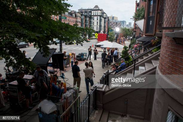 Production crews mill about the set of a new movie with Amy Schumer on Tremont Street in Boston on Aug 7 2017