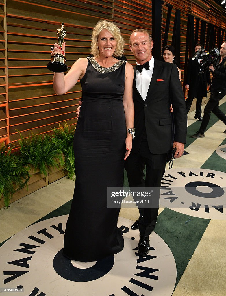 Production designer Beverley Dunn (L) and guest attend the 2014 Vanity Fair Oscar Party Hosted By Graydon Carter on March 2, 2014 in West Hollywood, California.