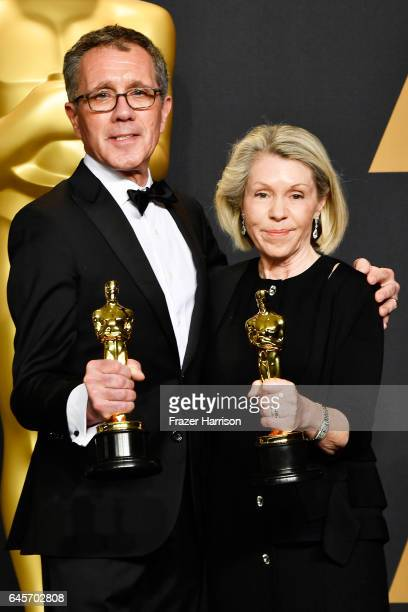 Production designer David Wasco and art director Sandy ReynoldsWasco winners of Best Production Design for 'La La Land' pose in the press room during...