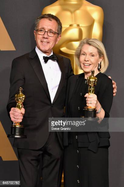 Production designer David Wasco and set decorator Sandy ReynoldsWasco winners of the award for Production Design for 'La La Land' pose in the press...