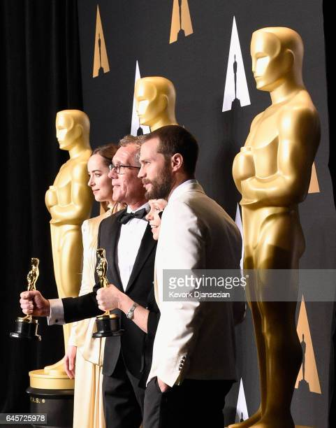 Production designer David Wasco and set decorator Sandy ReynoldsWasco winners of the award for Production Design for 'La La Land' pose with...