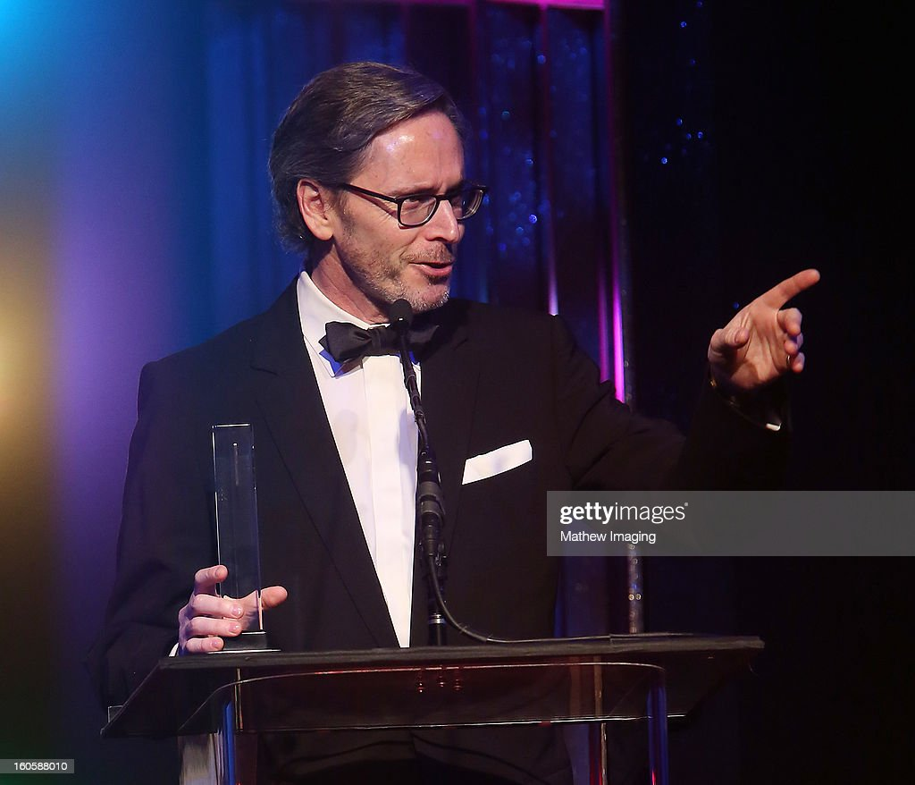 Production designer Keith Ian Raywood accepts the award for Excellence in Production Design for an Episodic of a Multi-Camera, Variety or Unscripted Series 2012 - Saturday Night Live 'Mick Jagger Host' at The 17th Annual Art Directors Guild Awards, held at the Beverly Hilton Hotel on February 2, 2013 in Beverly Hills, California.