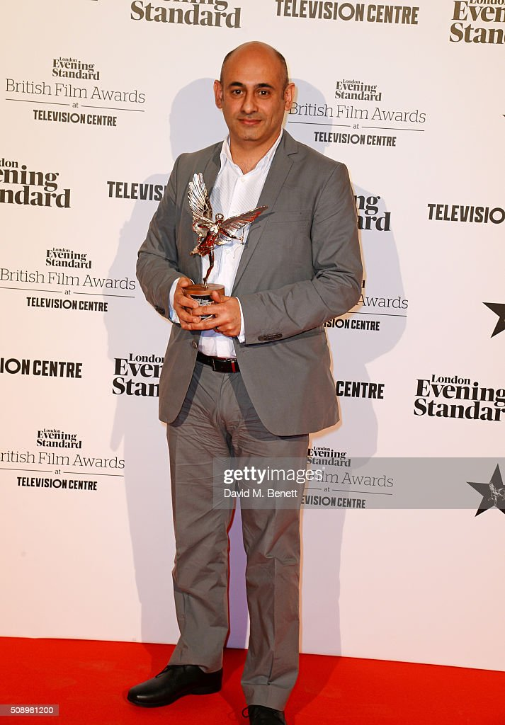 Production designer Mark Digby, winner of the Technical Achievement award for 'Ex-Machina', poses in front of the Winners Boards at the London Evening Standard British Film Awards at Television Centre on February 7, 2016 in London, England.
