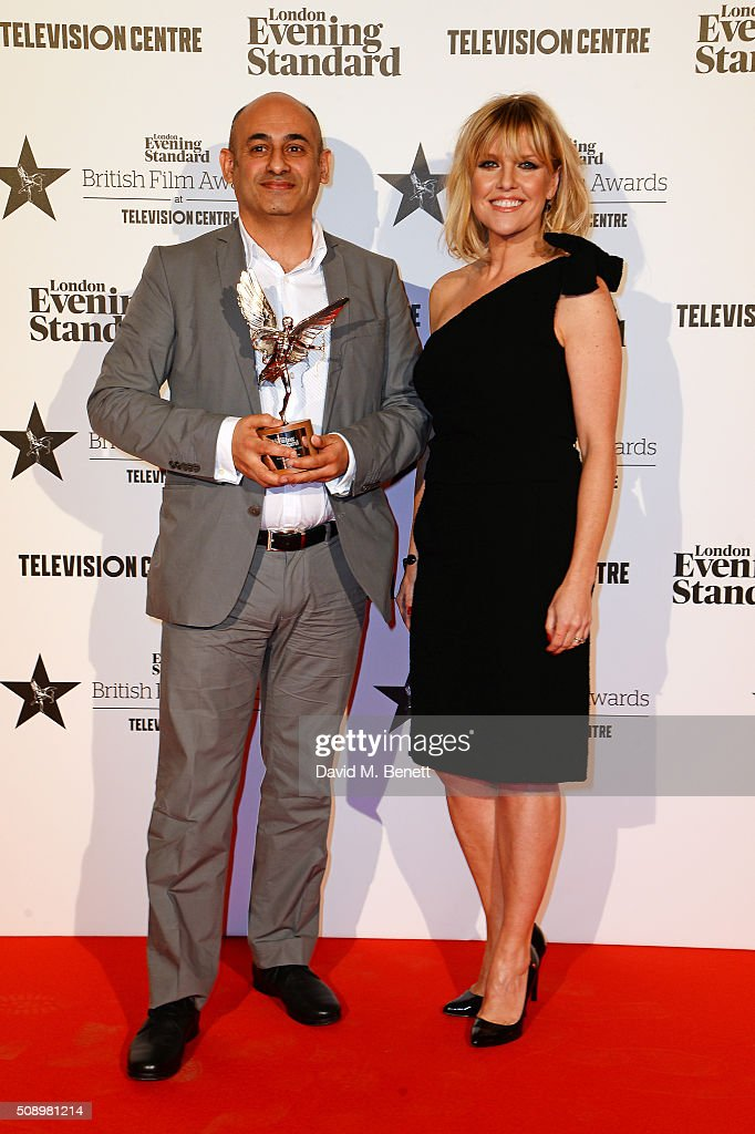 Production designer Mark Digby, winner of the Technical Achievement award for 'Ex-Machina', and presenter <a gi-track='captionPersonalityLinkClicked' href=/galleries/search?phrase=Ashley+Jensen&family=editorial&specificpeople=589548 ng-click='$event.stopPropagation()'>Ashley Jensen</a> pose in front of the Winners Boards at the London Evening Standard British Film Awards at Television Centre on February 7, 2016 in London, England.