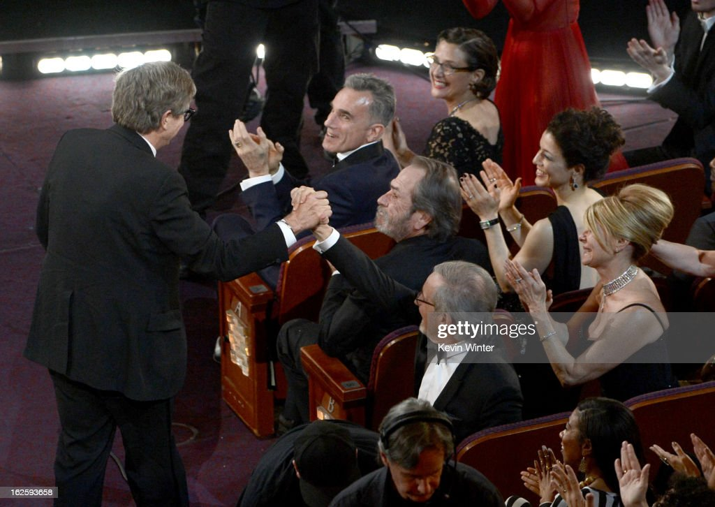 Production designer Rick Carter shakes hands with director Steven Spielberg before Carter accepts the Best Production Design award for 'Lincoln'...
