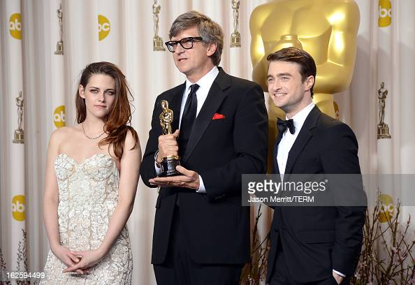 Production designer Rick Carter winner of the Best Production Design award for 'Lincoln' with presenters Kristen Stewart and Daniel Radcliffe pose in...