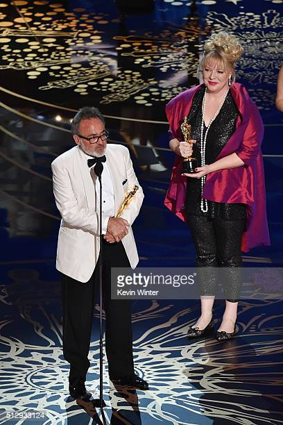Production designers Colin Gibson and Lisa Thompson accept the Best Production Design award for 'Mad Max Fury Road' onstage during the 88th Annual...
