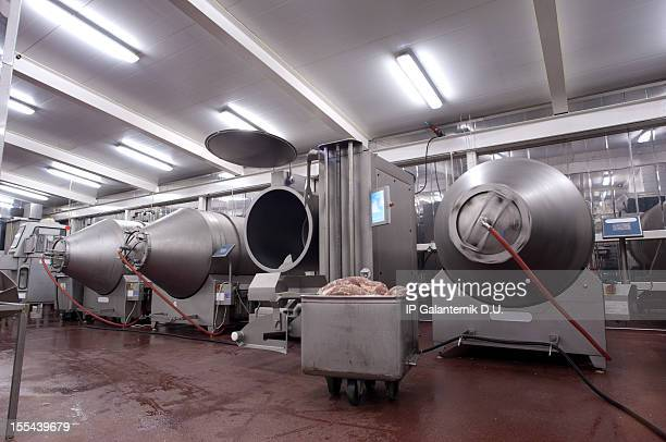Production line in a food factory. Meat products preparation.