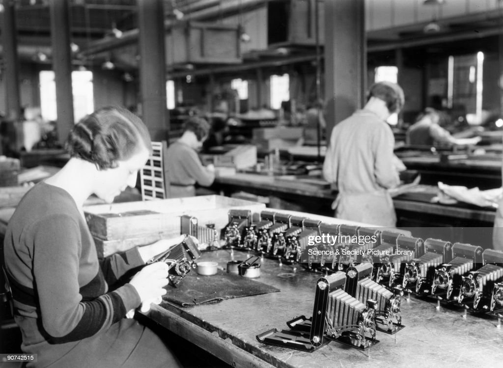Assembly Line Worker : Production line worker assembling a kodak camera harrow