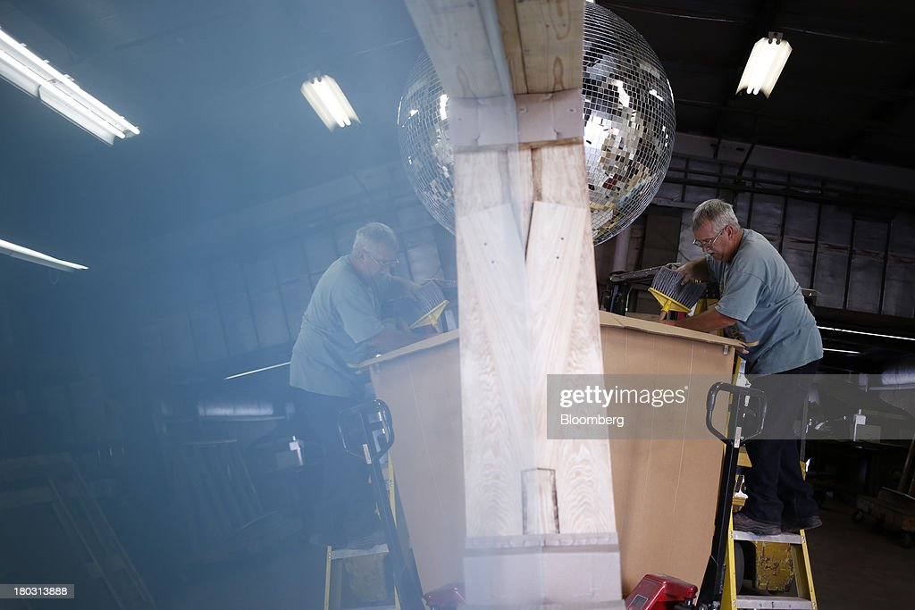 Production manager Ernie Miller arranges packaging inside a four foot disco ball box at the Omega National Products manufacturing facility in Louisville, Kentucky, U.S., on Tuesday, Sept. 10, 2013. The U.S. Federal Reserve is scheduled to release industrial production figures on Sept. 16. Photographer: Luke Sharrett/Bloomberg via Getty Images
