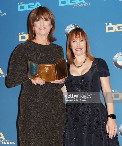 Production Manager Marie Cantin recipient of the Frank Capra Achievement Award poses with producer Gale Anne Hurd in the press room during the 69th...