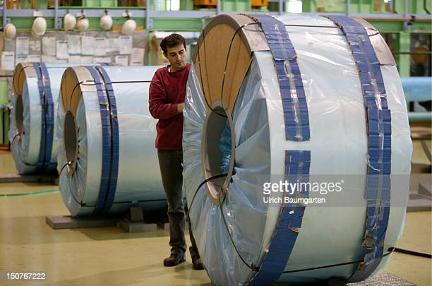 Production of steel in a works of the ThyssenKrupp Stahl AG Our picture shows worker at packing of the sheet steel rolls for the transportation