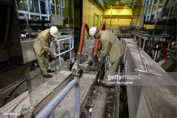 Production of steel in a works of the ThyssenKrupp Stahl AG Our picture shows worker above the zinc bath for refining the sheet steel
